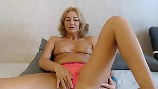 Mature woman in pink panties masturbates pussy