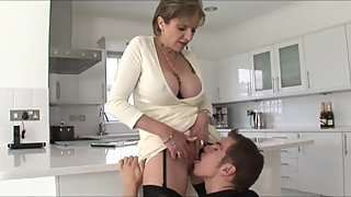 Sexy mature stepmother with big tits seduces and fucks her stepson