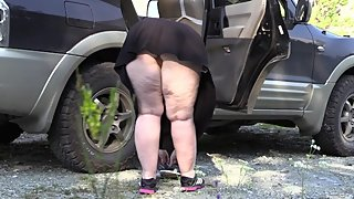Mature Busty BBW Changing Clothes Near Car