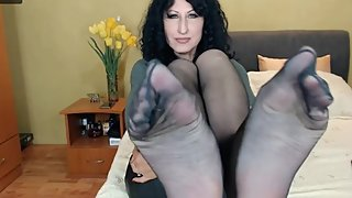 Mature shows big nylon feet on webcam