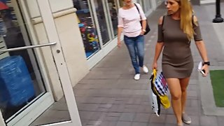 Candid voyeur thick ass MILF tight dress shopping mall