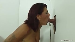Hot MILF sucking big dick and fucling like a pro in the gloryhole!