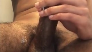 Teen shoots his cum on himself
