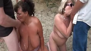 two milf bukkake at the beach!