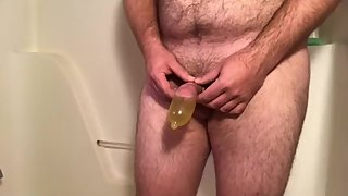 Filling a condom with cum then piss