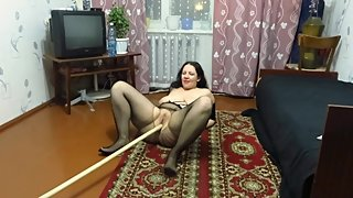 Mature girl masturbating her pussy with a stick
