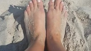 Footplay in the sand, sexy soft feet on the beach - amature