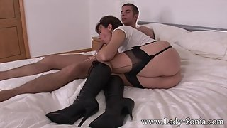 mistress in lace up boots uses her toy boy