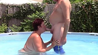 Chubby mature sucks cock and doggystyle in pool