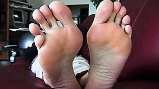 Shasta size 11 long toes laying on couch