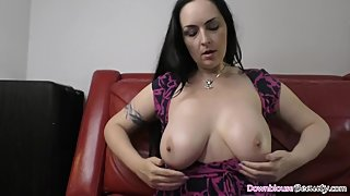 Brunette mature woman showing off her big natural tits