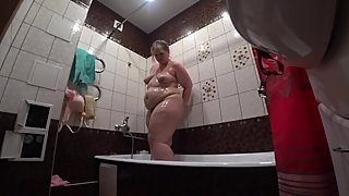 Beautiful juicy fat lady milf, washes in the shower