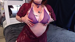 V269 Mature redhead in burgundy lace smokes and whispers dirty talk