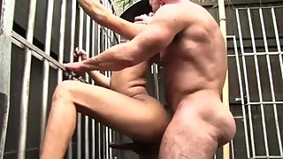 Muscle daddy pounds a cute twink with his huge cock