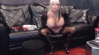 Mature opens legs in a high heels