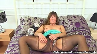 British milf Lelani gets busy with a sex toy