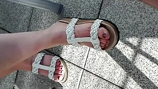 Sexy Feet with red nails in sandals