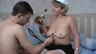 Drunk mature nurse playing with patient stethoscope